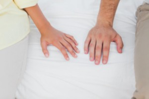 hands of couple in bed: SBD Medical Women's Issues blog