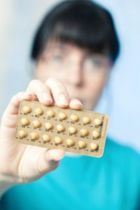 Woman holding birth control pills: SEOMedical Women's Issues Blog