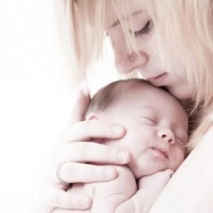 mom holding newborn: SBDMedical Motherhood blog