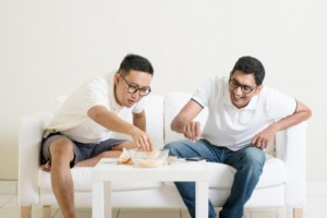 men talking and laughing: SBDMedical Men's Health Article
